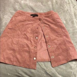 Pink button up mini skirt